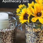 Apothecary jars with popcorn kernels, flower and candles