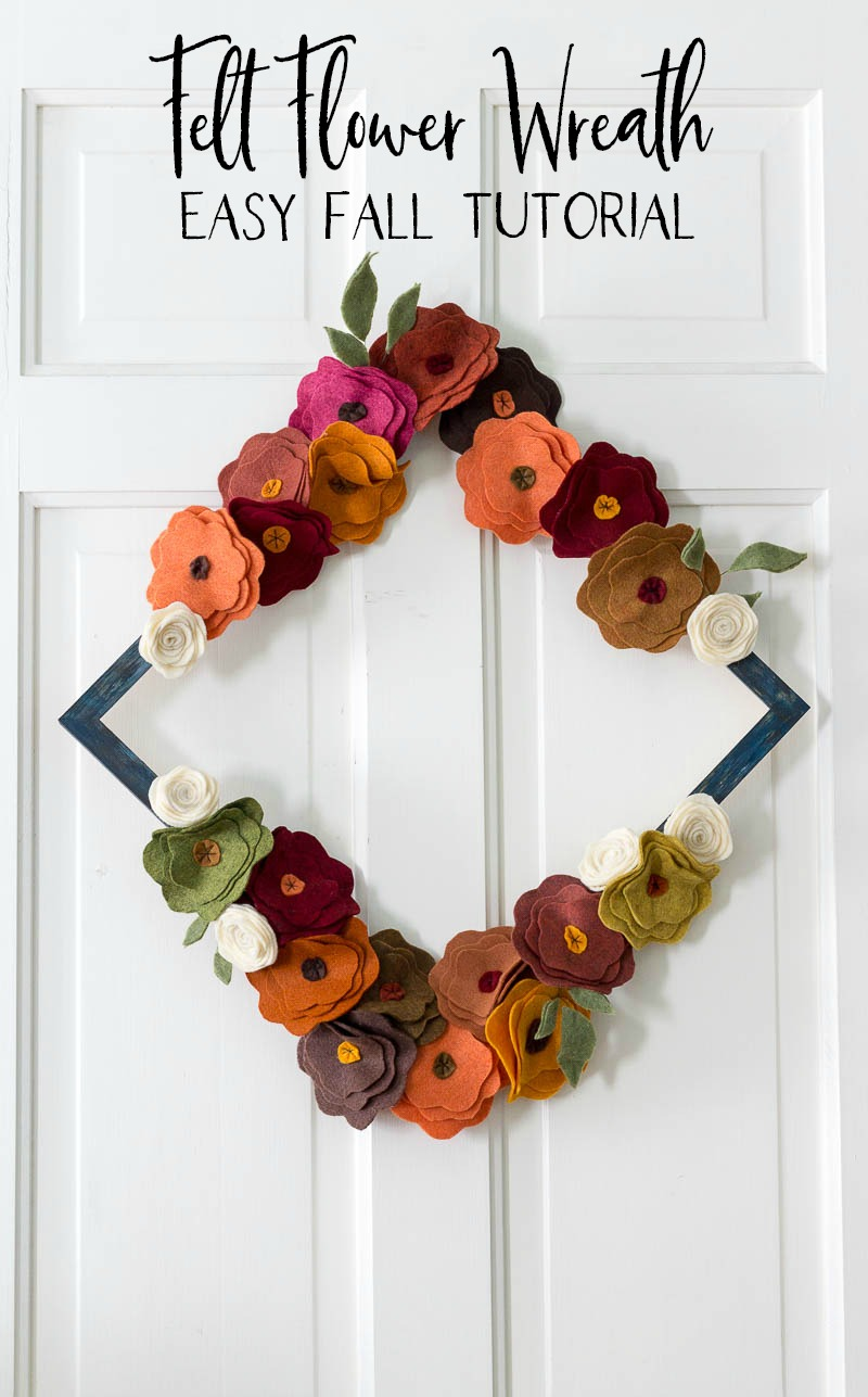 Fall colored felt flower wreath on white door