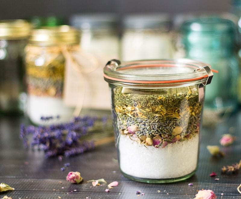 Using canning jars to store herbs and salts for the bath.