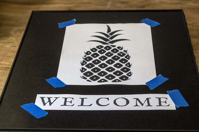 Pineapple image and welcome word taped to frame