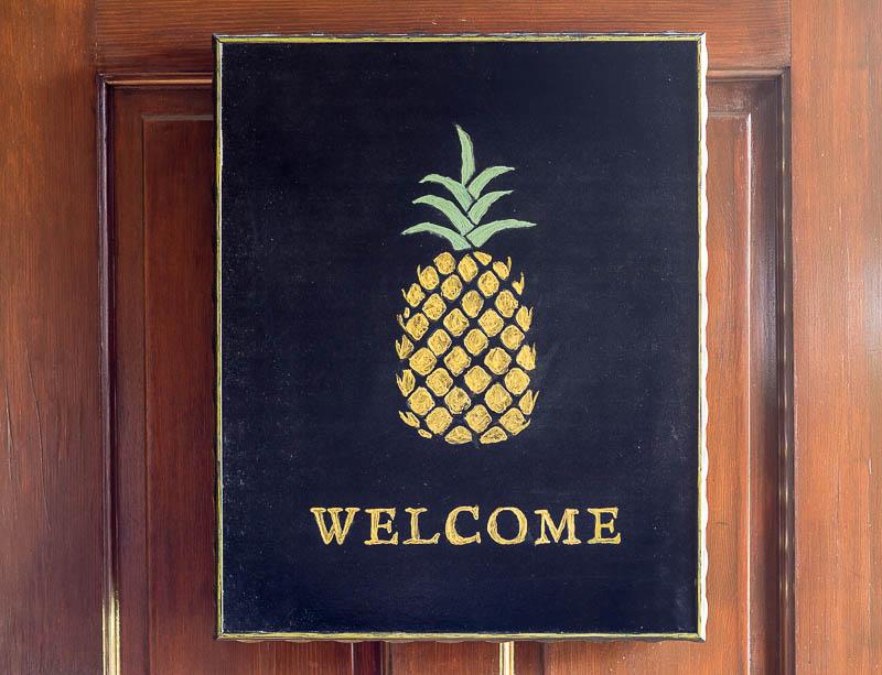 New pineapple welcome sign on door