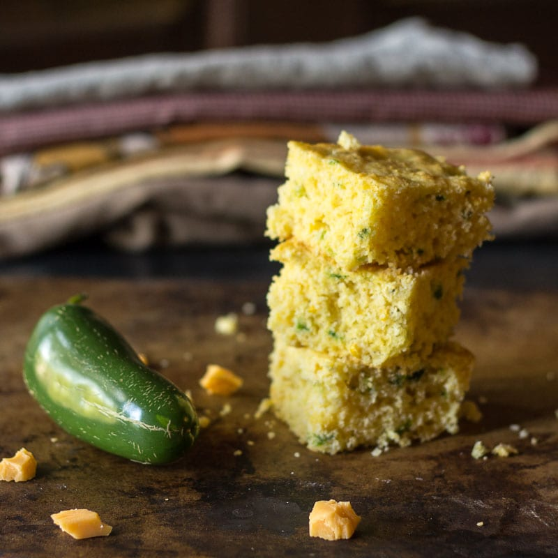 Smoky jalapeno cheddar cornbread is simple to make. The key is blistering jalapeno peppers over a flame to give the cornbread a nice smoky kick.