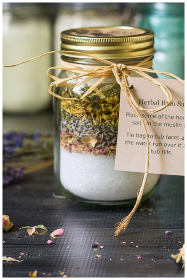 Layered herbs and bath salts in mason jar