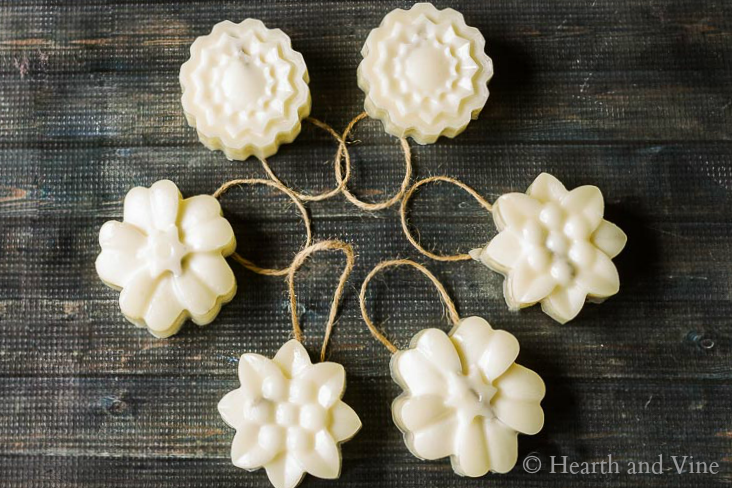 Circle of handmade scented beeswax ornaments on table