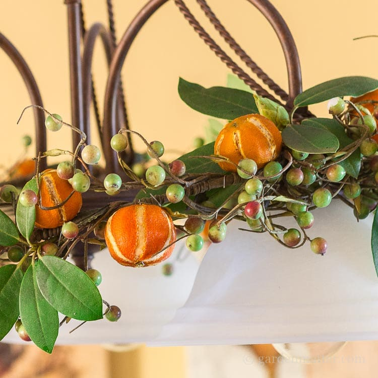 Dried citrus ornaments on chandelier