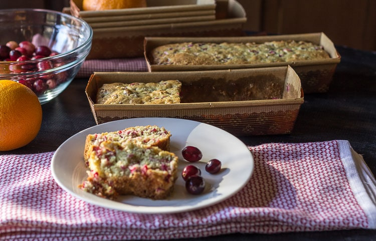 Slice of cranberry orange quick bread on plate