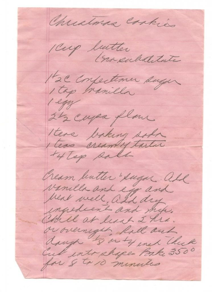 Pink ruled paper with handwritten Christmas cookie recipe on it.