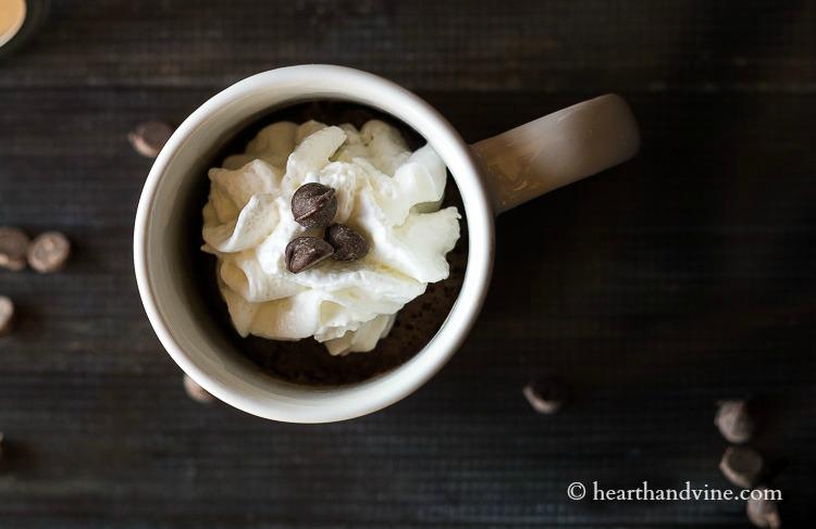 Mug cake in mug with whipped cream