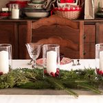 Easy Centerpiece with Fresh Greens Cranberries and Candles on a Wood Plank