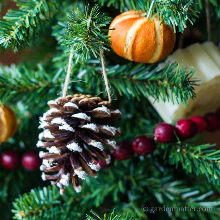 Handmade snow kissed ornament on the tree