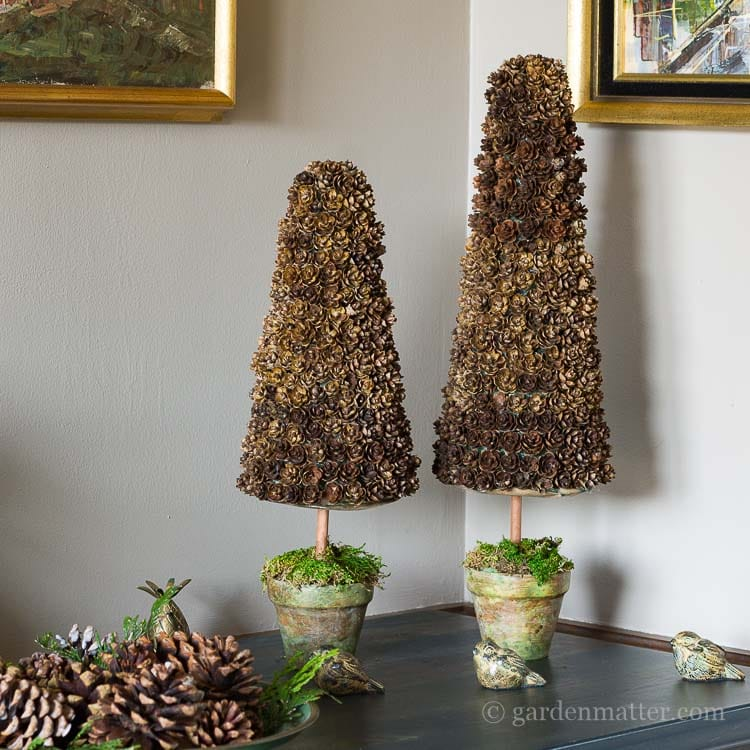 Learn how easy it is to make a pine cone Christmas tree.  Just a few materials are needed to create this rustic, piece for your holiday tabletop display.