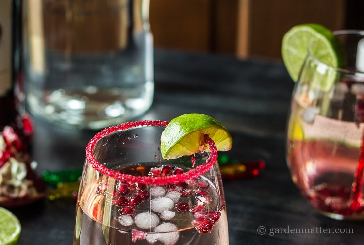 Use colored sugar to rim the glass of this Moscow Pom Cocktail