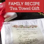A handwritten recipe transferred onto to a white tea towel with a holiday green and red border.
