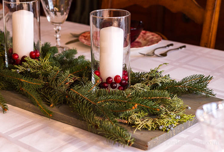 Wood candle cranberry and fresh evergreen centerpiece