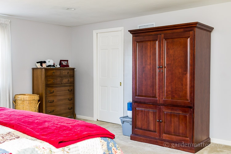 Armoire and tall dresser before view on the $100 room makeover challenge.