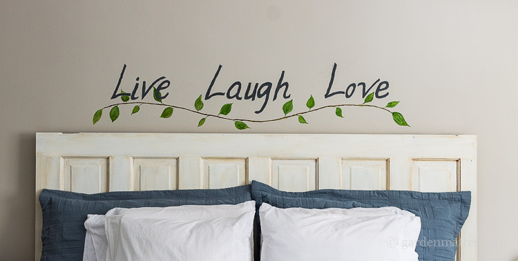 Budget bedroom makeover with handpainted wall art.