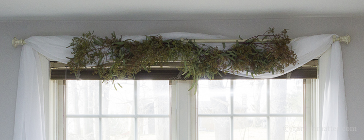 Fresh eucalyptus garland on bedroom window makeover
