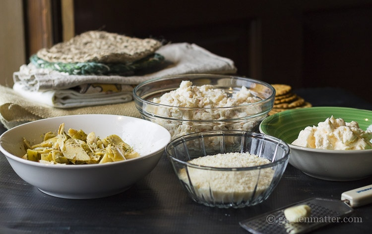 Ingredients for a hot cheesy crab and artichoke dip.