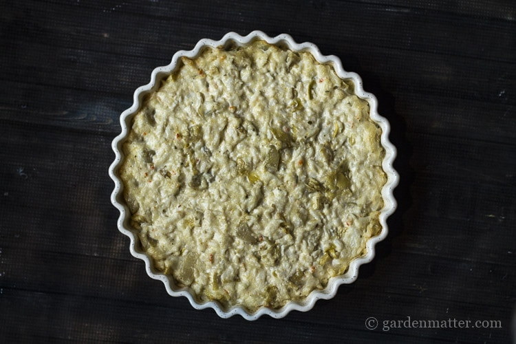 Cheesy crab artichoke dip is great appetizer to bring to any party.