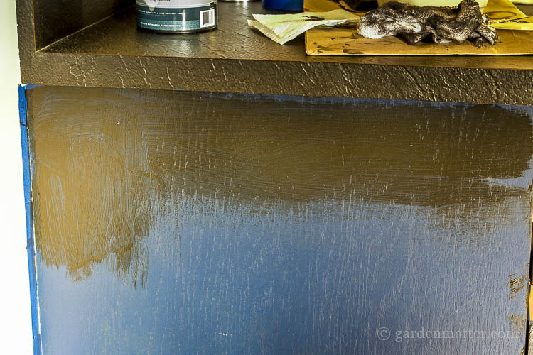 Painting bar cabinet with blue paint and black glaze.