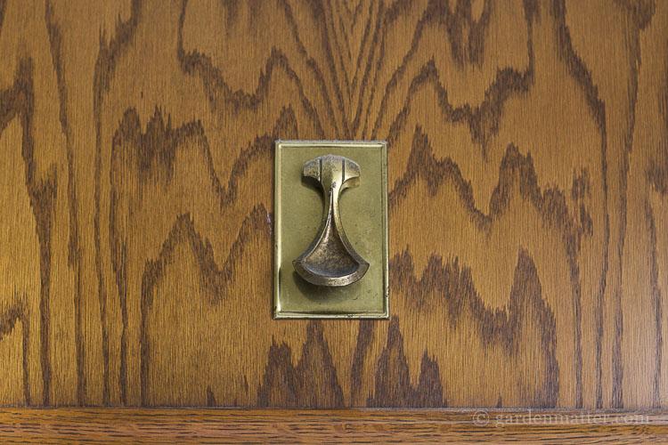 Original oak cabinet with brass pull.