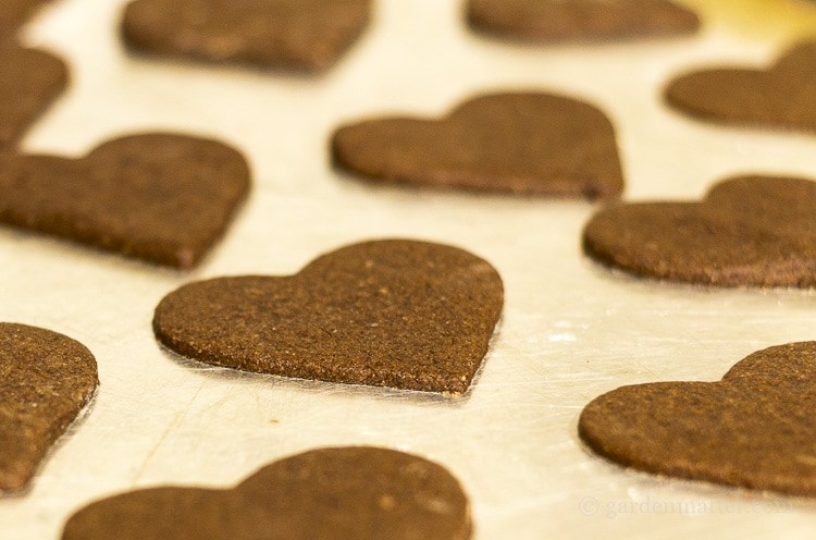 Chocolate sugar cut out cookies on baking sheet.