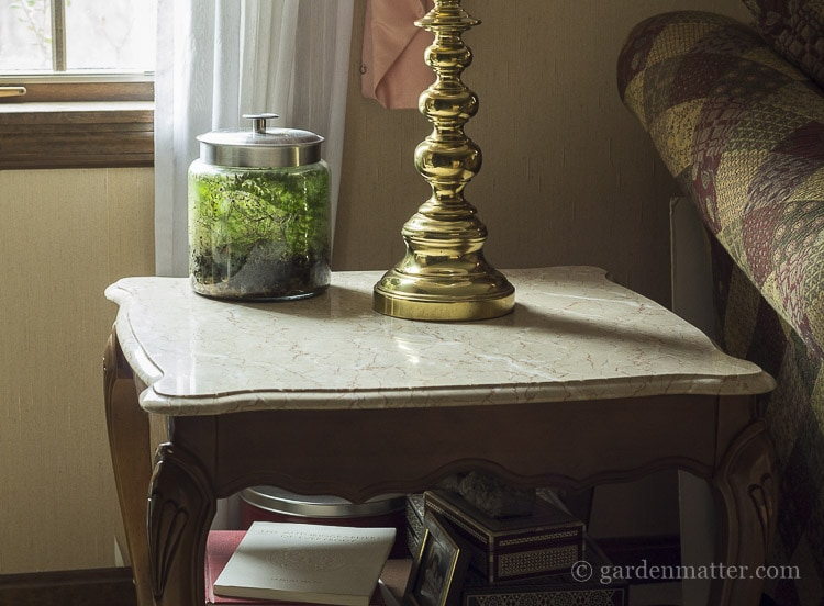 Living room end table with marble top.
