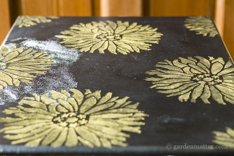 Stenciled end table with gold paint.