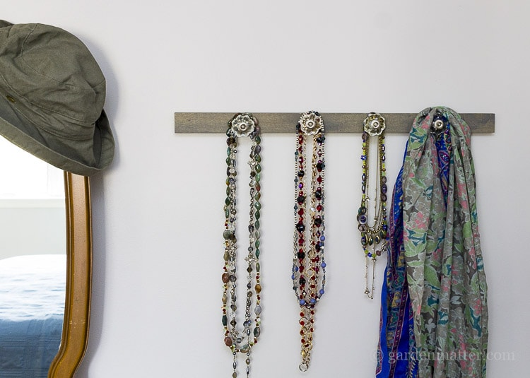 DIY drawer pulls on wood for a jewelry hanger.