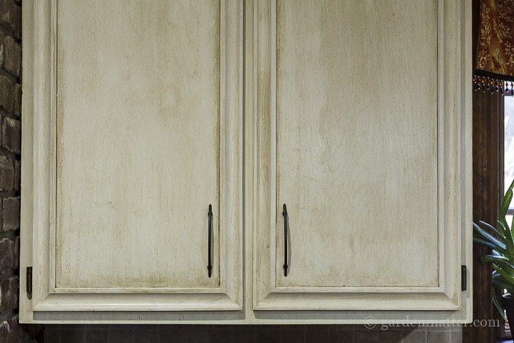 Painting oak cabinets in the kitchen.