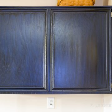 Painting oak cabinets with blue paint and black glaze.