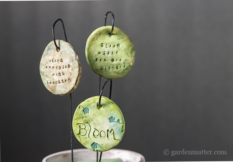 Garden charms with letter stamp.