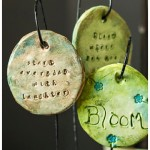 Clay garden charms hanging in pot