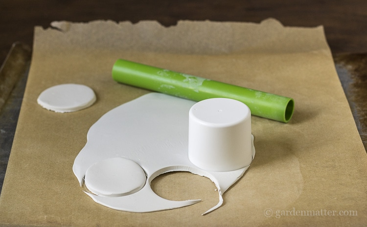 Cutting rounds of clay.