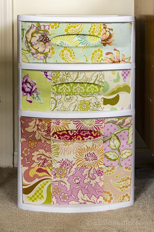 Learn how to beautify an old set of plastic drawers using mod podge and fabric. It's a great way to recycle and use extra fabric.