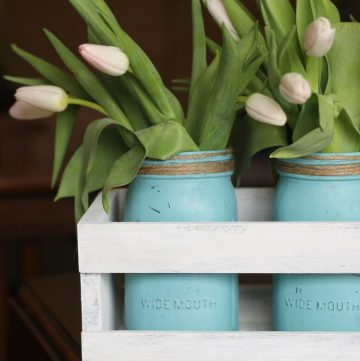 wood crate with aqua mason jars and tulips