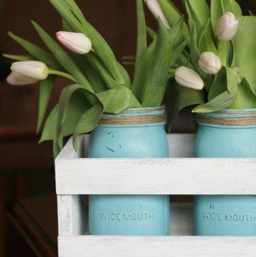 wood crate with aqua mason jars and tulips