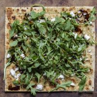 Arugula, goat cheese and fig balsamic drizzle flatbread.