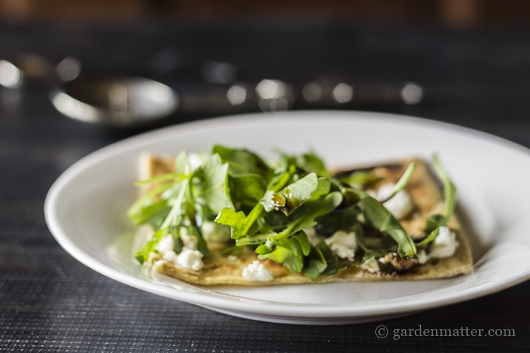 Goat Cheese and Arugula Flatbread with Fig Balsamic drizzle.