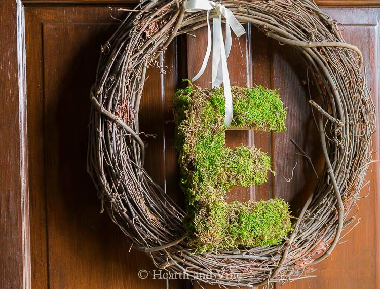 moss covered E on wreath