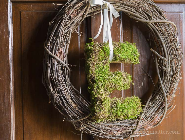 Easy grapevine wreath with natural sheet moss letter.