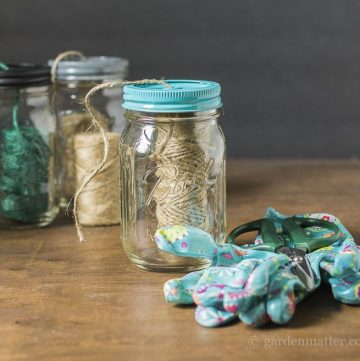 Using a mason jar to dispense your nature twine. Add glove and scissors to make it a gift.