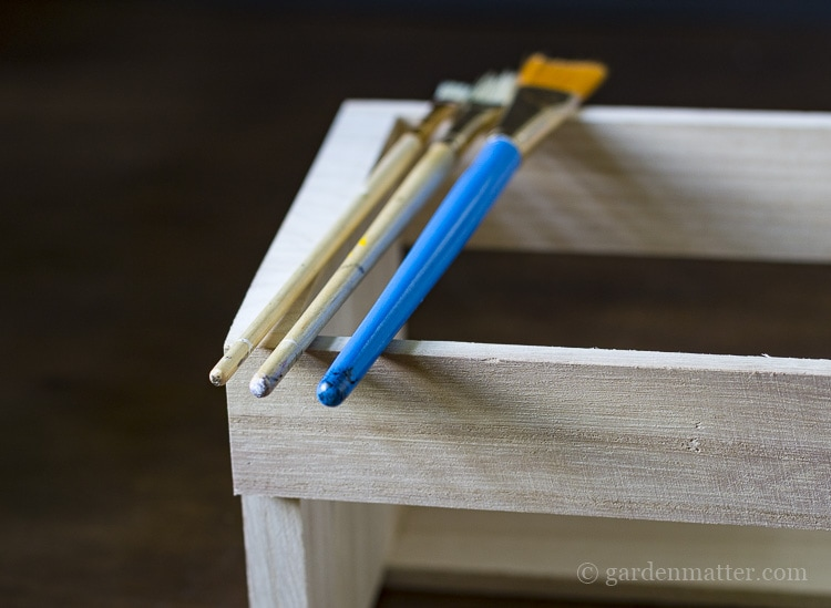 Ends of paint brushes to create varying sizes of dots.