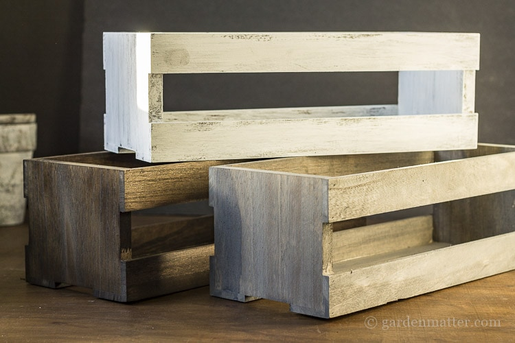 Three wood crates with different finishes