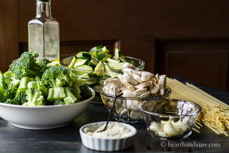 Broccoli, zucchini, mushroom, garlic, pasta, olive oil and Parmesan cheese.