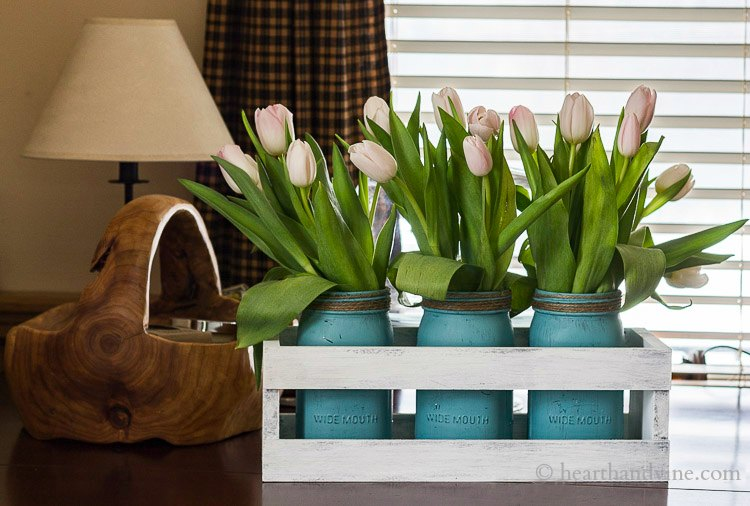 Aqua painted mason jars with white tulips