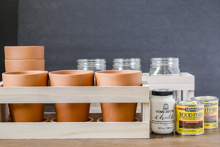 Materials to create wood crate flower centerpieces.