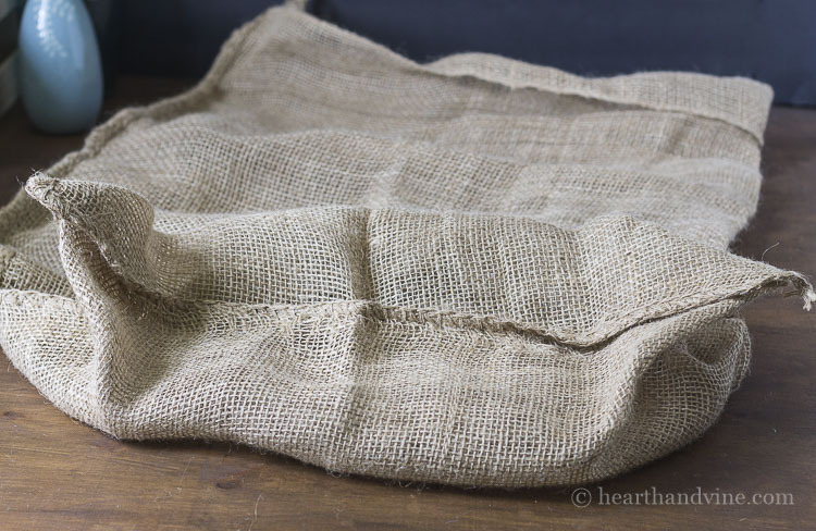 Bottom of burlap sack.