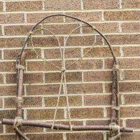 DIY garden trellis from branches in your backyard.
