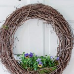 Grapevine wreath with live flowers planted in bottom.